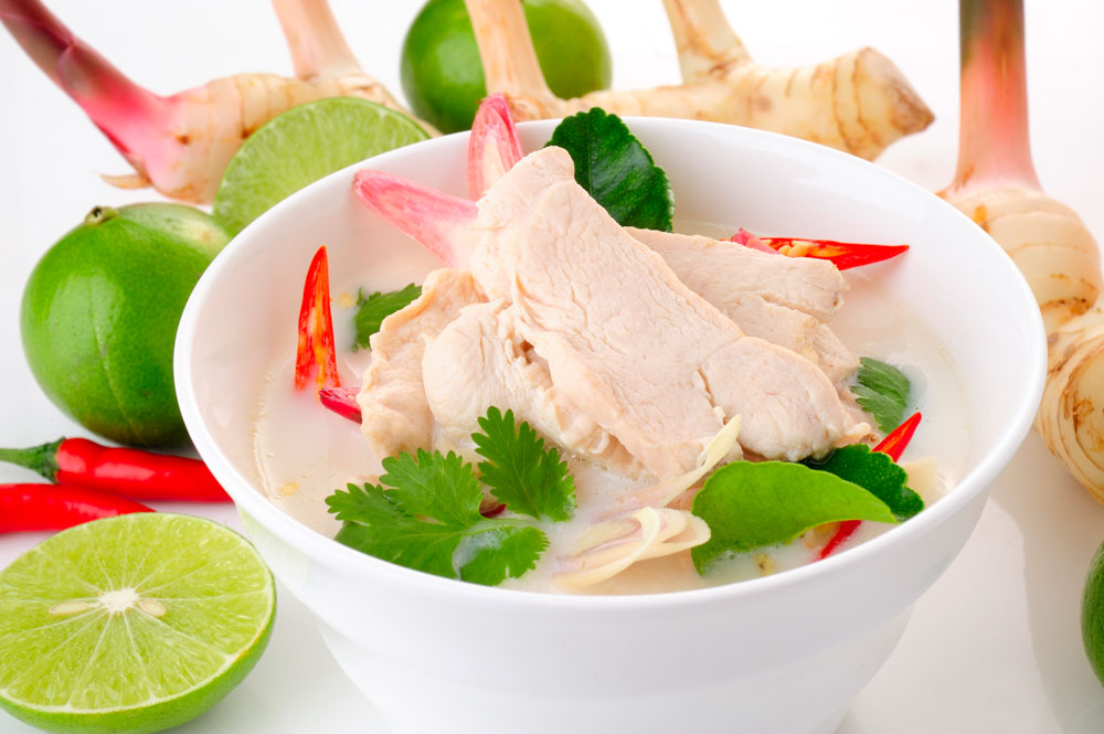 thai cuisine - tom kha kai - chicken in coconut milk soup