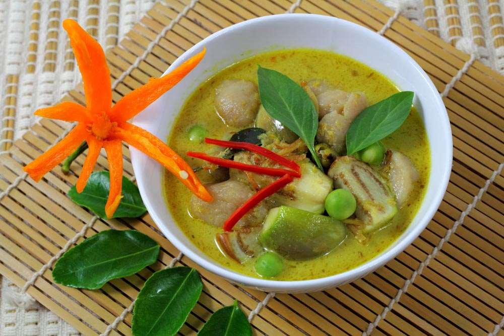 Massaman chicken curry on wooden table